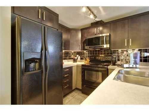 Main Photo: 310 1 Street SE in Calgary: Single Level Apartment for sale : MLS®# C3548056
