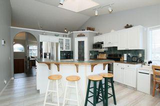 Photo 13: 306 WEST TERRACE Place: Cochrane House for sale : MLS®# C4117766