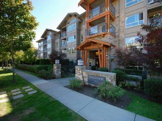 """Photo 2: 418 3110 DAYANEE SPRINGS BL in Coquitlam: Westwood Plateau Condo for sale in """"LEDGEVIEW"""" : MLS®# R2118967"""