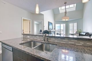 Photo 11: 2407 15 SUNSET Square: Cochrane Apartment for sale : MLS®# A1072593