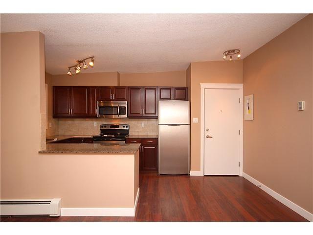 Photo 9: Photos: 1 605 67 Avenue SW in CALGARY: Kingsland Condo for sale (Calgary)  : MLS®# C3424392