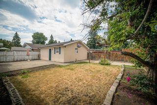 Photo 4: 12023 Candiac Road SW in Calgary: Canyon Meadows Detached for sale : MLS®# A1128675