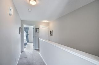 Photo 12: 314 Ascot Circle SW in Calgary: Aspen Woods Row/Townhouse for sale : MLS®# A1111264