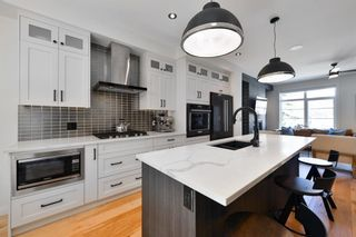 Photo 9: 115 41 Avenue SW in Calgary: Parkhill Row/Townhouse for sale : MLS®# A1100085