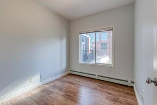 Photo 18: 400 881 15 Avenue SW in Calgary: Beltline Apartment for sale : MLS®# A1125479