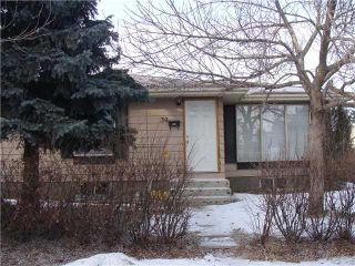 Photo 1: 30 ERIN RIDGE Place SE in CALGARY: Erinwoods Residential Detached Single Family for sale (Calgary)  : MLS®# C3602698