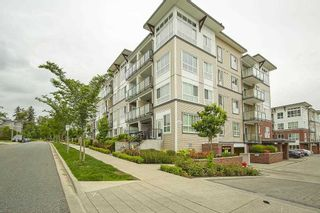 """Photo 1: 205 6468 195A Street in Surrey: Clayton Condo for sale in """"Yale Bloc Building 1"""" (Cloverdale)  : MLS®# R2456985"""
