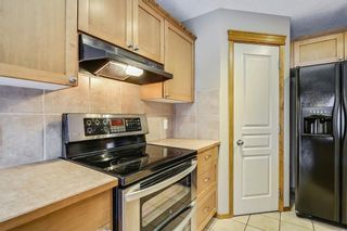 Photo 11: 38 SOMERSIDE Crescent SW in Calgary: Somerset House for sale : MLS®# C4142576