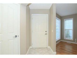 Photo 2: 74 WEST TERRACE Road: Cochrane House for sale : MLS®# C4073559