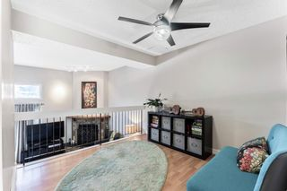 Photo 13: 108 Glamis Terrace SW in Calgary: Glamorgan Row/Townhouse for sale : MLS®# A1070053
