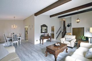 Photo 5: 335 Queensland Place SE in Calgary: Queensland Detached for sale : MLS®# A1137041