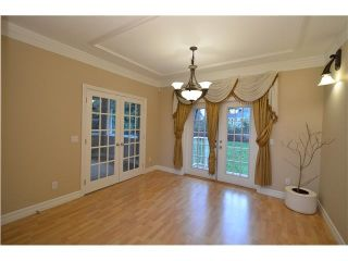 """Photo 8: 2201 HAVERSLEY Avenue in Coquitlam: Central Coquitlam House for sale in """"MUNDY PARK"""" : MLS®# R2141892"""