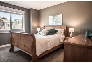 Photo 10: 95 West Coach Manor SW in Calgary: West Springs Row/Townhouse for sale : MLS®# A1114599