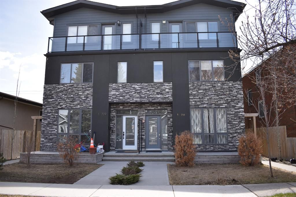 Main Photo: 1 711 17 Avenue NW in Calgary: Mount Pleasant Row/Townhouse for sale : MLS®# A1100885