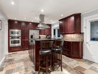Photo 11: 207 WILLOW RIDGE Place SE in Calgary: Willow Park Detached for sale : MLS®# C4302398