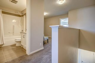 Photo 18: 100 Legacy Main Street SE in Calgary: Legacy Row/Townhouse for sale : MLS®# A1095155
