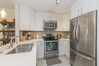 "Photo 4: 213 1869 SPYGLASS Place in Vancouver: False Creek Condo for sale in ""VENICE COURT"" (Vancouver West)  : MLS®# R2461533"