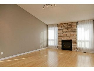 Photo 3: 80 WOODBINE Boulevard SW in Calgary: Woodbine Residential Detached Single Family for sale : MLS®# C3645592