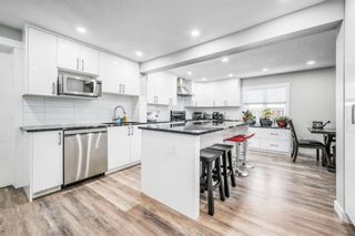 Photo 7: 6403 35 Avenue NW in Calgary: Bowness Detached for sale : MLS®# A1124607