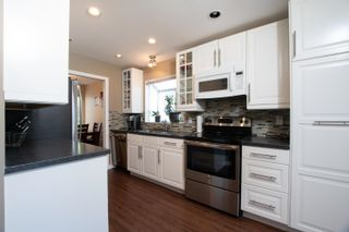 """Photo 7: 141 12233 92 Avenue in Surrey: Queen Mary Park Surrey Townhouse for sale in """"ORCHARD LAKE"""" : MLS®# R2594301"""