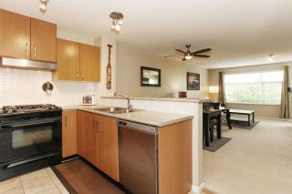 """Photo 9: 209 400 KLAHANIE Drive in Port Moody: Port Moody Centre Condo for sale in """"Tides"""" : MLS®# R2192368"""