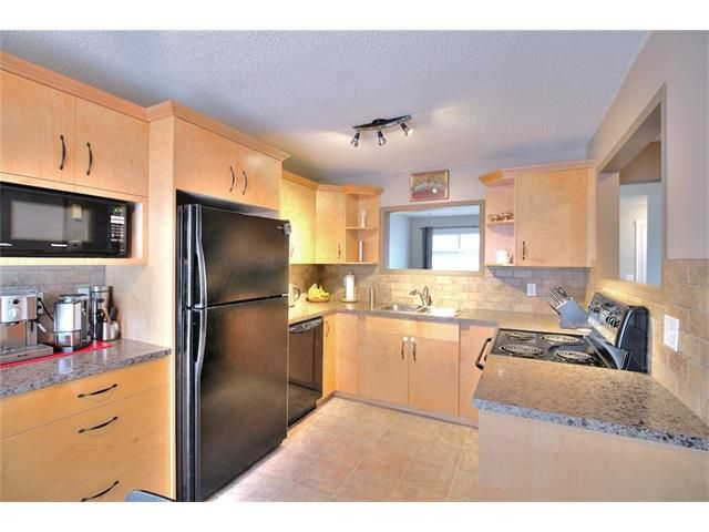 Photo 10: Photos: 108 SHAWGLEN Road SW in Calgary: Shawnessy House for sale : MLS®# C4038520