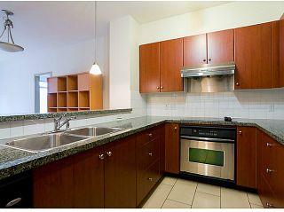 Photo 1: # 311 200 CAPILANO RD in Port Moody: Port Moody Centre Condo for sale : MLS®# V1032496