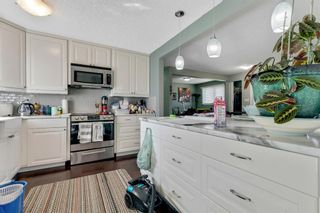 Photo 12: 739 64 Avenue NW in Calgary: Thorncliffe Detached for sale : MLS®# A1086538