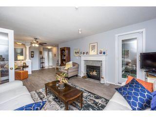 "Photo 4: 208 13860 70 Avenue in Surrey: East Newton Condo for sale in ""CHELSEA GARDENS"" : MLS®# R2160632"