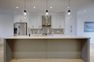Photo 8: 306 30 Avenue NE in Calgary: Tuxedo Park Semi Detached for sale : MLS®# C4283291