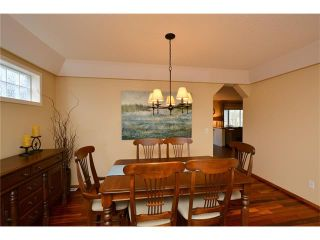 Photo 7: 108 GLENEAGLES Terrace: Cochrane House for sale : MLS®# C4113548
