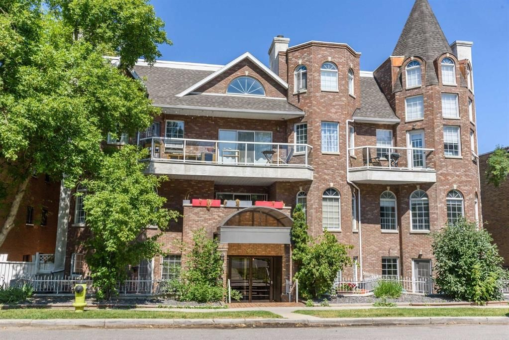 Main Photo: 103 916 19 Avenue SW in Calgary: Lower Mount Royal Row/Townhouse for sale : MLS®# A1064917