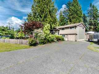 "Photo 1: 4084 202A Street in Langley: Brookswood Langley House for sale in ""BROOKSWOOD"" : MLS®# R2465158"