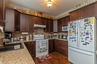 """Photo 14: 34745 3RD Avenue in Abbotsford: Poplar House for sale in """"HUNTINGDON VILLAGE"""" : MLS®# R2580704"""