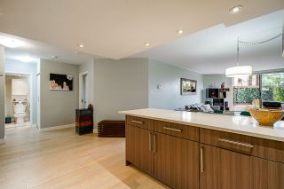 """Photo 6: 102 1450 PENNYFARTHING Drive in Vancouver: False Creek Condo for sale in """"HARBOUR COVE"""" (Vancouver West)  : MLS®# R2560607"""