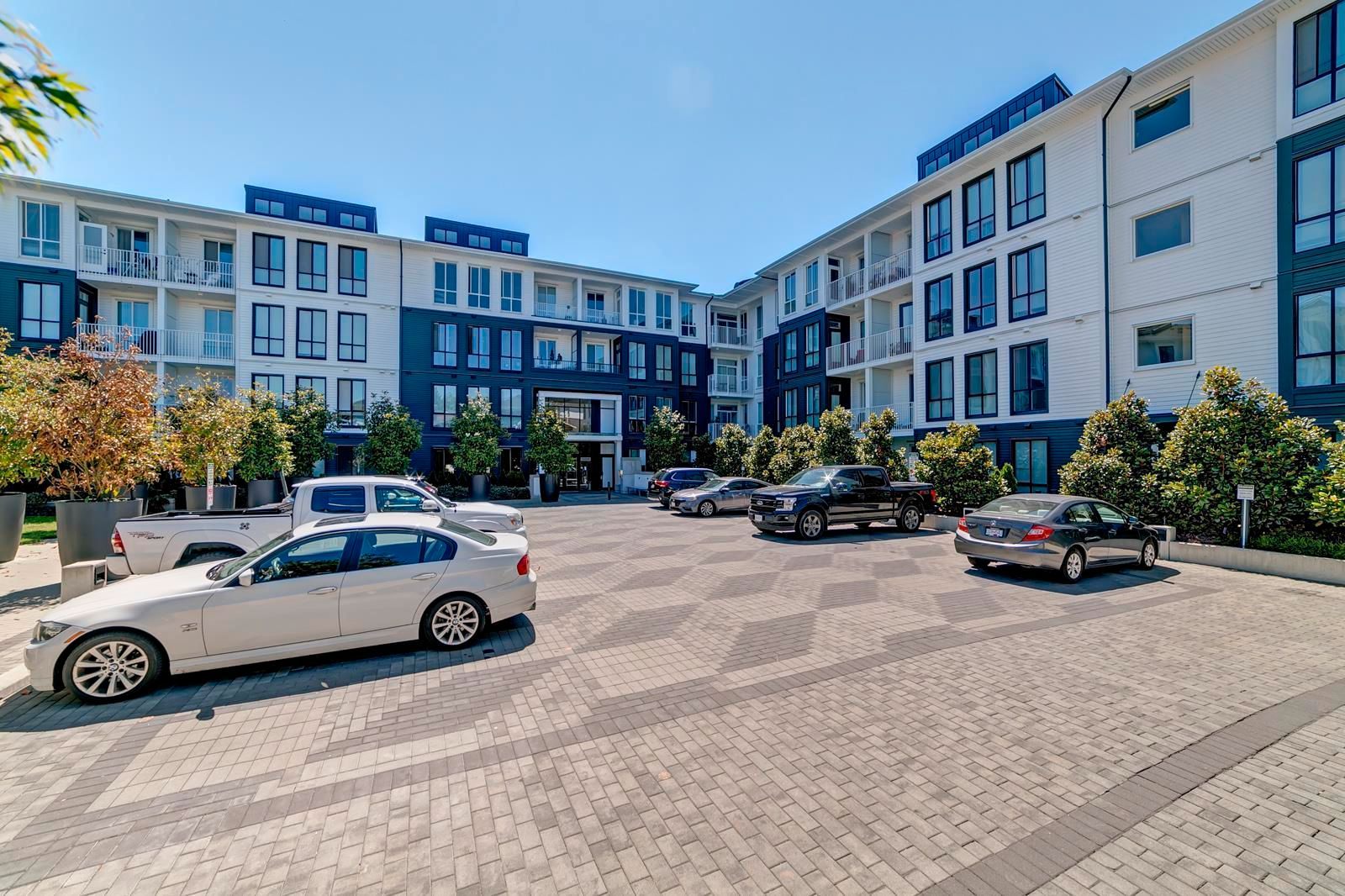 """Main Photo: 328 14968 101A Avenue in Surrey: Guildford Condo for sale in """"Mosaic Guildhouse"""" (North Surrey)  : MLS®# R2603317"""