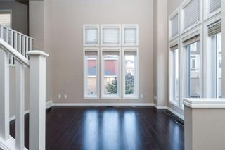 Photo 2: 1402 Auburn Bay Square SE in Calgary: Auburn Bay Row/Townhouse for sale : MLS®# A1103124