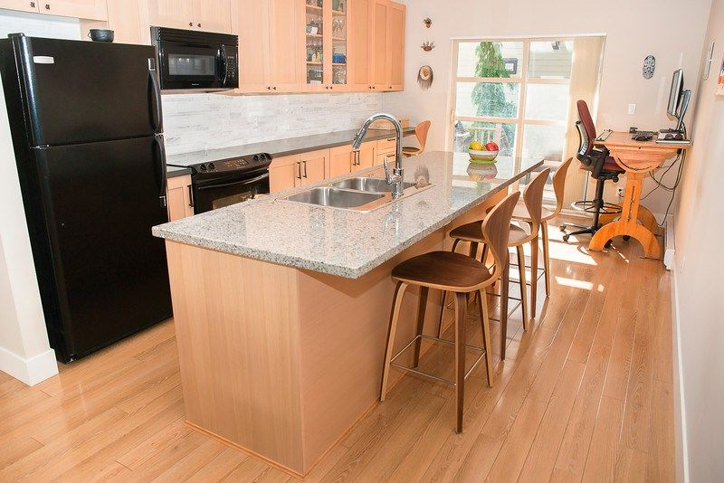 Remodeled and extended with amazing quartz surface tons of built ins and pull outs including a built in work space. Makes a good kitchen space extraordinary!