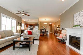 """Photo 2: 408 20286 53A Avenue in Langley: Langley City Condo for sale in """"CASA VERONA"""" : MLS®# R2177236"""