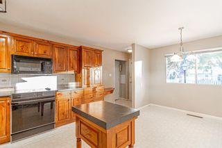 Photo 8: 7223 Kananaskis Drive SW in Calgary: Kelvin Grove Detached for sale : MLS®# A1100740