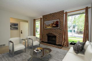 Photo 2: 6519 Coach Hill Road SW in Calgary: Coach Hill Semi Detached for sale : MLS®# A1129484