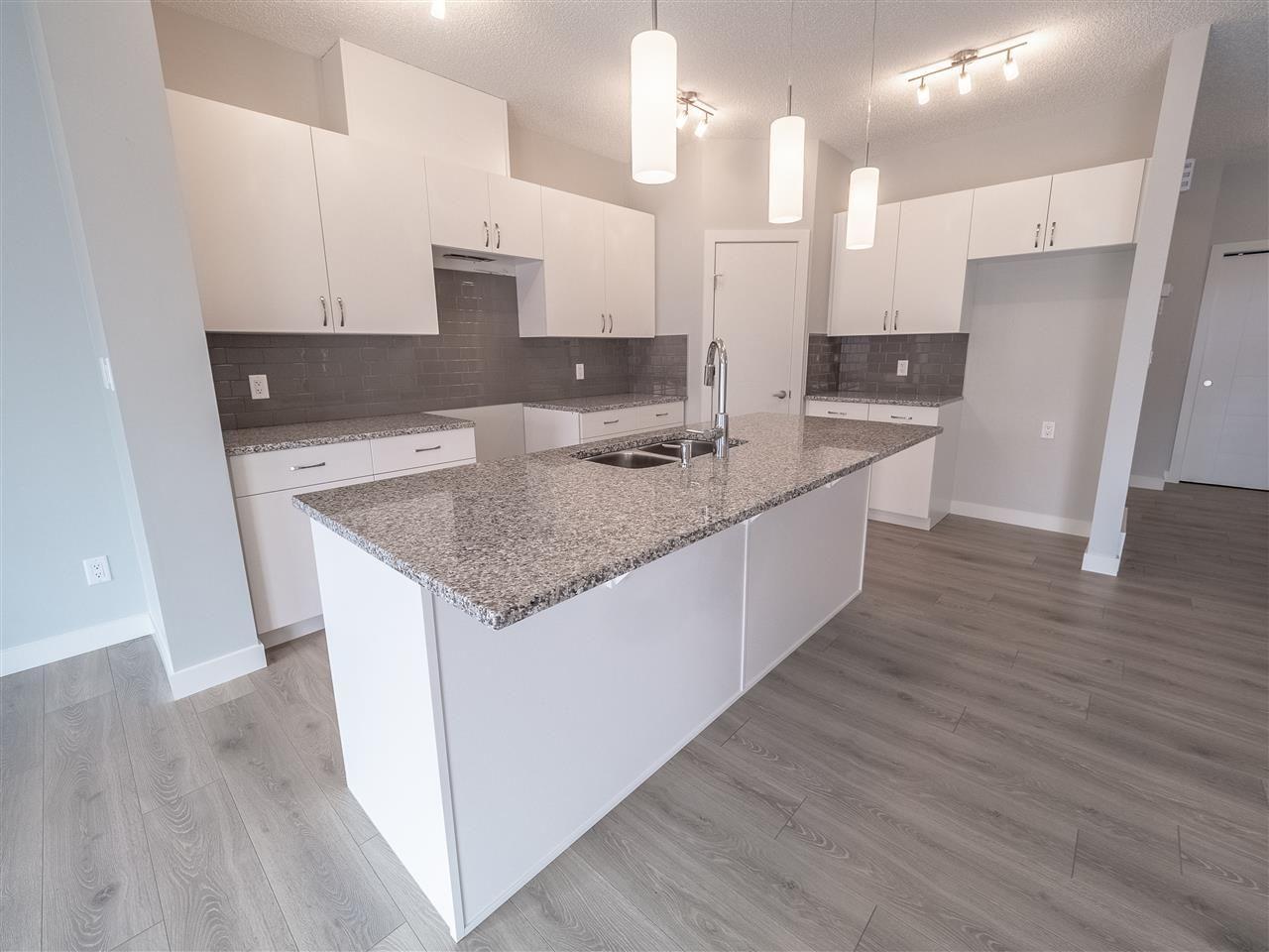 Main Photo: 225 39A Avenue in Edmonton: Zone 30 House Half Duplex for sale : MLS®# E4224008