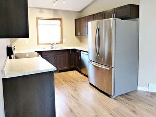Photo 5: 107 Mt Allan Circle SE in Calgary: McKenzie Lake Detached for sale : MLS®# A1068557