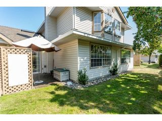 """Photo 19: 9769 148A Street in Surrey: Guildford Townhouse for sale in """"Chelsea Gate"""" (North Surrey)  : MLS®# R2394189"""