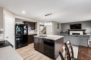 Photo 4: 133 Tuscany Meadows Place in Calgary: Tuscany Detached for sale : MLS®# A1126333