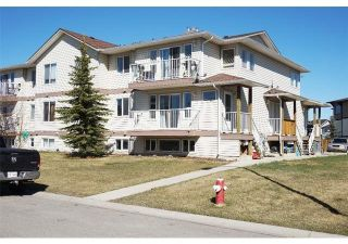Photo 1: 102 604 19 Street SE: High River Apartment for sale : MLS®# A1114065