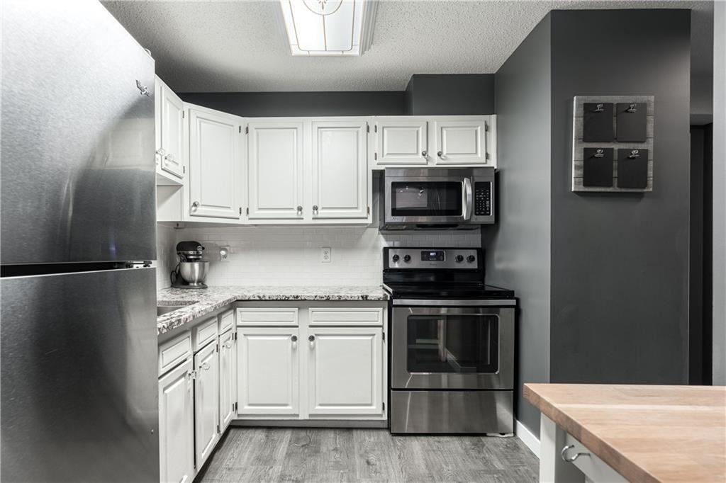 Photo 6: Photos: 1007 2520 PALLISER DR SW in Calgary: Oakridge Row/Townhouse for sale : MLS®# C4297041