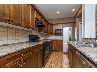 """Photo 3: 36014 STEPHEN LEACOCK Drive in Abbotsford: Abbotsford East House for sale in """"Auguston"""" : MLS®# R2158751"""