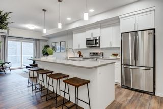Main Photo: 104 360 Harvest Hills Common NE in Calgary: Harvest Hills Apartment for sale : MLS®# A1137075