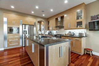 Photo 13: 30 Strathridge Park SW in Calgary: Strathcona Park Detached for sale : MLS®# A1151156